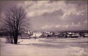 Ak La Cure Kt. Waadt Schweiz, Blick auf die Ortschaft im Winter