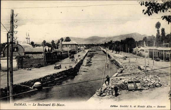 Ak Damaskus Syrien, Le Boulevard El Nassr, Straße am Fluss
