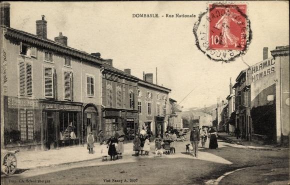 Ak Dombasle sur Meurthe Lothringen Meurthe et Moselle, Rue Nationale, Geschäfte, Straßenansicht