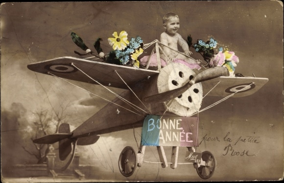 Ak Bonne Année, Glückwunsch Neujahr, Baby auf einem Flugzeug, Blumen