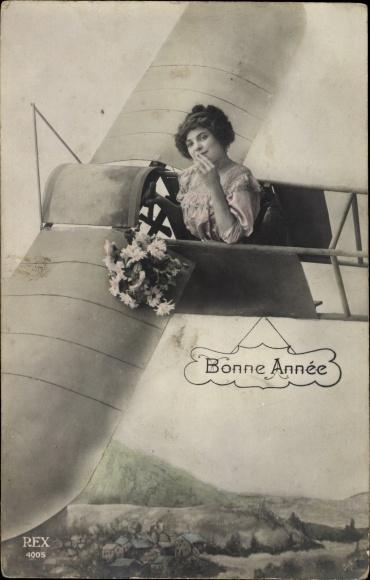 Ak Bonne Année, Glückwunsch Neujahr, Frau in einem Flugzeug, Blumenstrauß