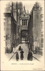Ak Bruges Brügge Flandern Westflandern, Blick in die Rue de l'Ane Aveugle, Passanten