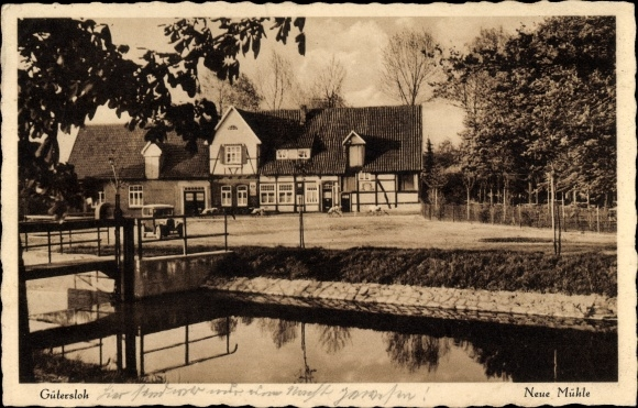 Ak Gütersloh in Westfalen, Neue Mühle, Besitzer H. Dirksmöller, Fluss, Brücke