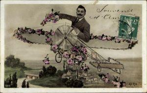 Ak Souvenir d'amitié, Mann in einem Flugzeug, Rosenblüten, Fotomontage