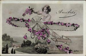 Ak Amitiés, Mädchen in einem Flugzeug, Rosenblüten, Fotomontage