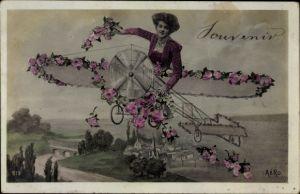 Ak Frau in einem Flugzeug, Souvenir, Rosenblüten, Fotomontage