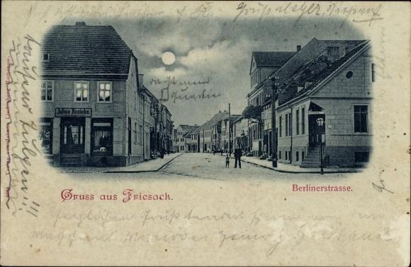 Mondschein Ak Friesack im Havelland, Berliner Straße, Schneidermeister Julius Rusicke, Apotheke