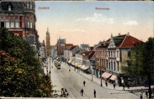 Ak Krefeld am Niederrhein, Blick in die Rheinstraße, Straßenbahn, Geschäfte, Friseur