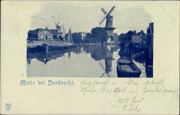 Ak Dordrecht Südholland Niederlande, Teilansicht vom Ort beim Fluss mit Blick zur Windmühle