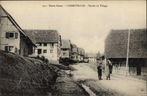 Ak Ueberstraße Elsass Haut Rhin, Entree du Village, Fachwerkhäuser, Straßenpartie im Ort
