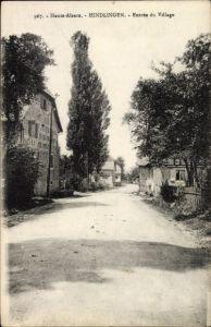 Ak Hindlingen Elsass Haut Rhin, Entrée du Village, Straßenpartie