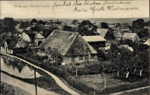 Ak Norderstapel in Schleswig Holstein, Stadtpanorama, Blick auf ein Reetdach Haus