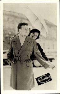 Ak Reklame, Velmeline, Mann im Mantel, Frau mit Regenschirm, Regenmantel