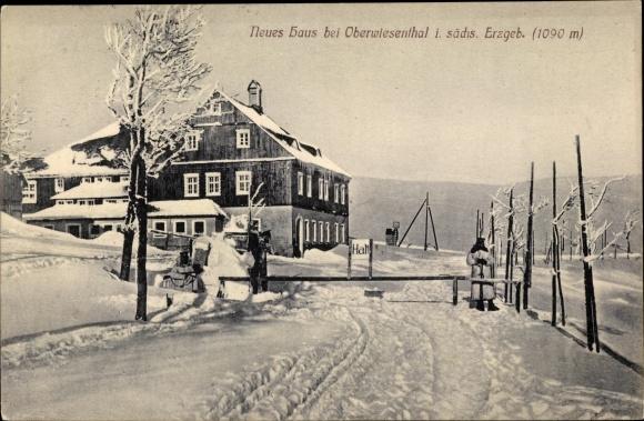 Ak Oberwiesenthal im Erzgebirge Sachsen, Neues Haus im Winter