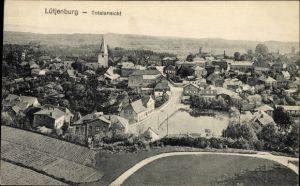 Ak Lütjenburg in Schleswig Holstein, Panoramablick über den Ort, Kirche