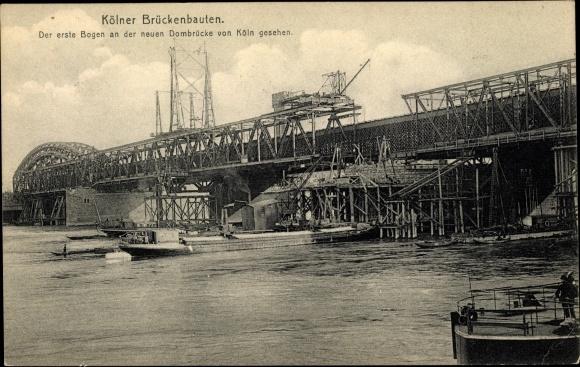 Ak Köln am Rhein, Blick auf die Dombrücke, von der Stadt gesehen, mit I. Bogen, im Bau