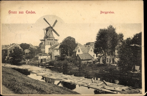 Ak Emden in Ostfriesland, Burgraben, Windmühle, Teilansicht der Stadt