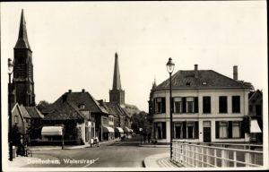 Ak Doetinchem Gelderland, Waterstraat, Stadtansicht, Glockenturm, Straßenpartie