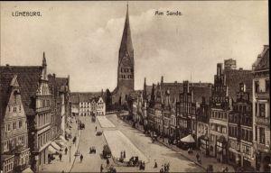Ak Lüneburg in Niedersachsen, Am Sande, Straßenpartie mit Blick zur Kirche, Geschäfte