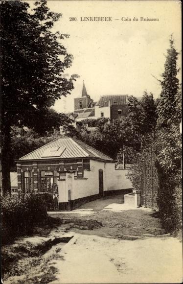 Ak Linkebeek Flandern Flämisch Brabant, Coin du Ruisseau, Teilansicht mit Kirche