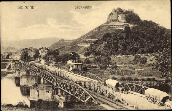 Ak Bad Münster am Stein Ebernburg Bad Kreuznach, Nahepartie mit Blick zur Ebernburg, Planwagen