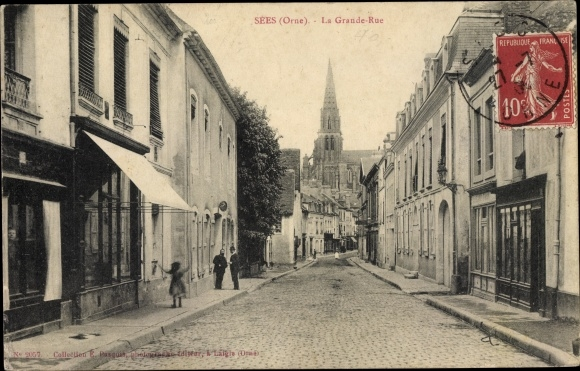 Ak Sees Orne, La Grande Rue, Blick zur Kirche, Geschäfte