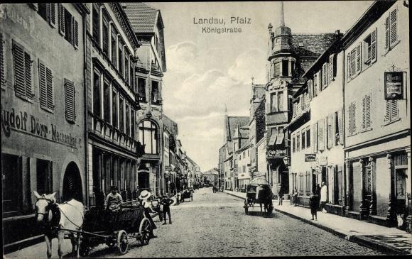 Ak Landau in der Pfalz, Königstraße, Mechaniker Rudolf Dörr, Cafe, Fuhrwerke