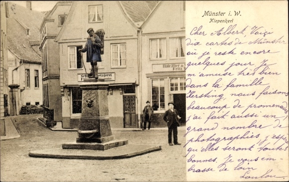 Ak Münster in Westfalen, Kiepenkerl Denkmal, Straßenpartie, Passanten