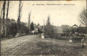 Ak Traubach le Haut Obertraubach Elsass Haut Rhin, Entrée du Village, Straßenpartie