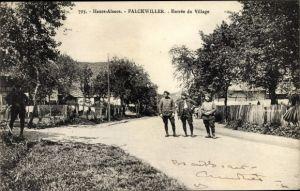 Ak Falkwiller Falkweiler Elsass Haut Rhin, Entrée du Village, Straßenpartie