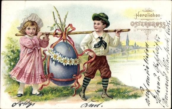 Ak Glückwunsch Ostern, Kinder mit einem riesigen Osterei