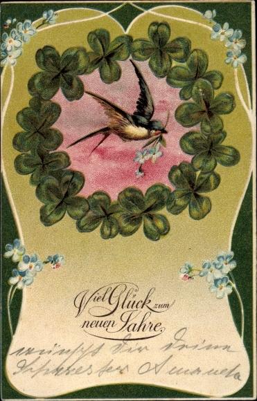 Präge Litho Glückwunsch Neujahr, Schwalbe mit Blume im Schnabel, Kleeblätter
