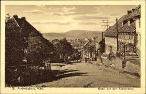 Ak St. Andreasberg Braunlage im Harz, Blick auf den Sieberberg, Straßenpartie