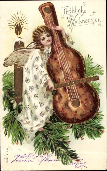 Weihnachtsessen Celle.Ak Frohe Weihnachten Engel Spielt Auf Einem Cello Lebkuchen Kerze