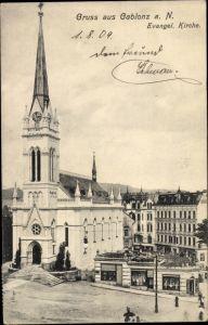 Ak Jablonec nad Nisou Gablonz an der Neiße Reg. Reichenberg, Evangelische Kirche, Geschäftshaus