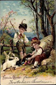 Präge Litho Glückwunsch Ostern, Zwei Kinder mit bunten Ostereiern und zwei weiße Hasen