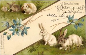 Präge Litho Glückwunsch Ostern, Fünf Hasen auf einer Wiese, Blüten