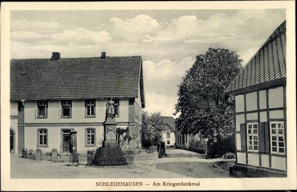 Ak Schledehausen Bissendorf in Niedersachsen, Am Kriegerdenkmal, Straßenpartie 0