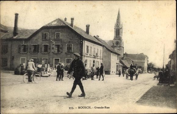 Ak Moosch Elsaß Elsass Haut Rhin, Grande Rue, Straßenpartie, Kirche 0