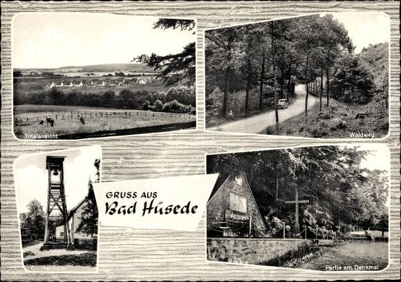 Ak Hüsede Bad Essen in Niedersachsen, Totalansicht, Waldweg, Glockenturm, Partie am Denkmal