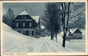 Ak Potůčky Breitenbach Reg. Karlsbad, Die Dreckschänke im Winter, Straßenansicht