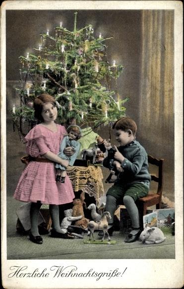 Ak Glückwunsch Weihnachten, Junge und Mädchen mit Geschenken, Puppe, Weihnachtsbaum, Teddy