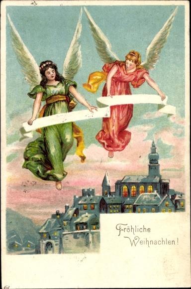 Präge Litho Frohe Weihnachten, Engel mit Spruchband, beleuchtete Stadt