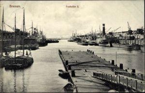 Ak Hansestadt Bremen, Freihafen II, Dampfer, Kräne, Segelschiff, Lagerhallen