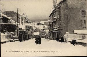 Ak Gérardmer Lothringen Vosges, La Rue de la Gare sous la Neige, Winter