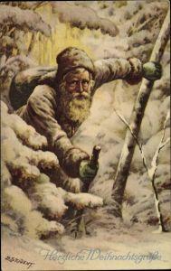 Künstler Ak Student, E., Frohe Weihnachten, Weihnachtsmann im Schnee