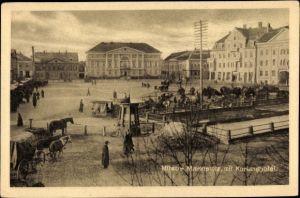 Ak Jelgava Mitau Lettland, Marktplatz mit Kurlandhotel, Fuhrwerke