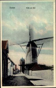 Ak Xanten am Niederrhein, Mühle am Wall, Windmühle, Straßenpartie