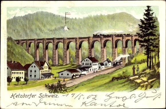 Künstler Ak Hetzdorf Halsbrücke Mittelsachsen, Panorama m. Eisenbahn auf Brücke und am Bahnhof