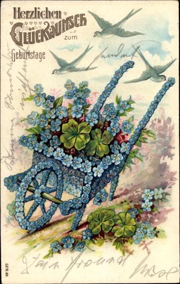 Litho Glückwunsch Geburtstag, Schubkarre aus Vergissmeinnichtblüten, Kleeblätter, Vögel